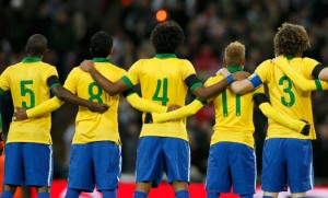 Brazilplayers prepare for their national anthem